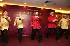 President Cheng (middle) leads the senior management to demonstrate a few steps of the Yang style Taiji.